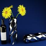 Bottiglia bruni con contenitore a lato e fiore
